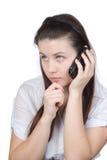 Die Frau mit einem zellularen Telefon Stockfotos