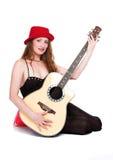 Die Frau mit einer Gitarre Lizenzfreie Stockfotos