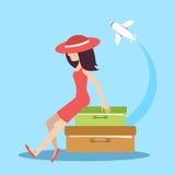 Die Frau mit Koffern stockbild