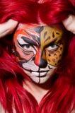 Die Frau mit Tigergesicht in Halloween-Konzept Lizenzfreies Stockbild