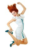 Die Frau springend in Studio Lizenzfreie Stockfotos