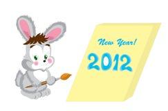 Die freundlichen Hasen des neuen Jahres mit einem Pinsel Lizenzfreie Stockfotos