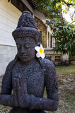 Die Göttin mit Blume Stockfoto