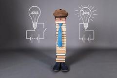 Die Geburt von Ideen, lustiges Bildungskonzept Stockbilder