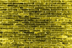 Die gelbe Ziegelsteinwand stockfoto