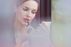 Die Geschäftsfrau, die sie verbessert, bilden Stockbild