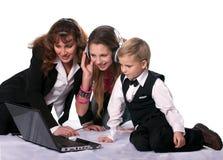 Die Geschäftsfrau und ihre Kinder Lizenzfreies Stockbild