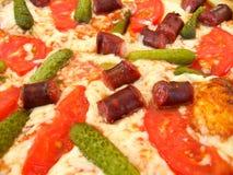 Die geschmackvolle appetitanregende Pizza Stockfoto
