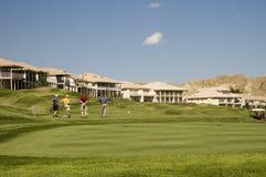 Die Golf spielenden Reichen Stockfotos