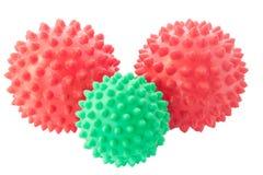 Die grünen und roten Kugeln mit Spitzen. Stockbild