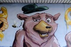 Die Graffiti, die ein Schwein darstellen, mögen Gesicht stockfotos