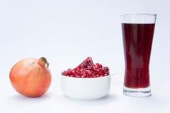 Die Granatapfelfrucht ist in den Vitaminen reich Essen Sie eine Frucht oder einen Saft Lizenzfreies Stockfoto