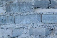 Die graue Backsteinmauer Stockbild
