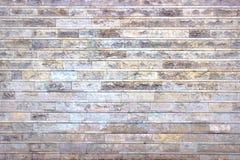 Die graue Wand von Steinblöcken, heller Hintergrund des Marmors Stockfoto