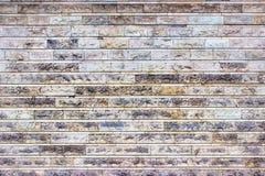 Die graue Wand von Steinblöcken, heller Hintergrund des Marmors Stockbild