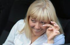 Die green-eyed junge Frau Stockfoto
