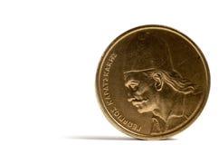 Die griechische Münze auf einer weißen Tabelle? Lizenzfreie Stockfotografie