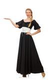 Die große Frau im langen schwarzen Kleid stockbild