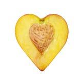 Die Hälfte des Pfirsiches in Form von Herzen Stockbilder