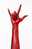 Die Hände des roten Teufels mit schwarzen Nägeln, rote Hände des Satans, Halloween-Thema, auf einem weißen Hintergrund, lokalisie Stockfotos
