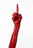 Die Hände des roten Teufels mit schwarzen Nägeln, rote Hände des Satans, Halloween-Thema, auf einem weißen Hintergrund, lokalisie Lizenzfreie Stockfotos