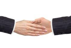 Die Hand der Frauen geht zur Hand des Mannes, die auf Weiß lokalisiert wird Lizenzfreie Stockbilder