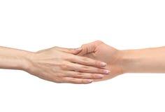 Die Hand der Frauen geht zur lokalisierten Hand des Mannes Stockfotografie