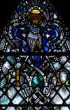 Die Hand des Gottes im Buntglas: der Anfang und das Ende Stockfotografie