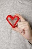 Die Hand des Kindes mit einem roten Inneren Lizenzfreie Stockbilder