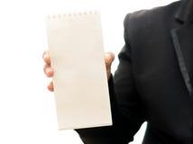 Die Hand des Mannes, die Visitenkarte - Nahaufnahmeschuß lokalisiert auf Whit zeigt Stockbild