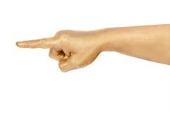 Die Hand des Mannes Goldzeigt einen Finger Stockfotos