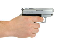 Die Hand des Mannes mit einem Gewehr lizenzfreie stockfotos