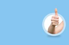 Die Hand, die Daumen zeigt, up Geste Stockbild
