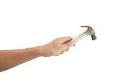 Die Hand, die einen Hammer hält. stockbilder