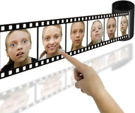 Die Hand, die einen Schuß mit differend Mädchen wählt, schaut Lizenzfreie Stockbilder