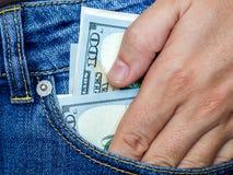 Die Hand erhält Dollar von einer Tasche Lizenzfreie Stockbilder