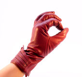 Die Hand im Handschuh, der die Geste zeigt Stockbild