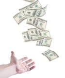 Die Hand möchten fallendes Geld fangen Lizenzfreie Stockfotografie