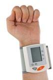 Die Hand mit dem tonometer. Stockbild