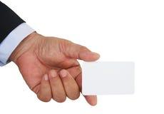 Die Hand und die weiße Karte des Geschäftsmannes stockfotografie