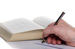 Die Handschrift des Mannes auf Papier lizenzfreies stockbild