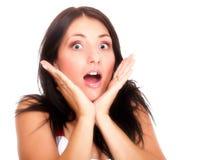 Die helle Abbildung der hübschen Frau erstaunt mit überreicht Mund Stockfoto