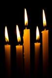Die Helligkeit des Kerzenlichtes Stockbild