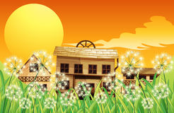 Die Holzhäuser an der Spitze der Hügel lizenzfreie abbildung