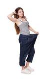 Die junge Frau, die von der Gewichtsverlustdiät glücklich ist, resultiert, lokalisiert Lizenzfreies Stockbild