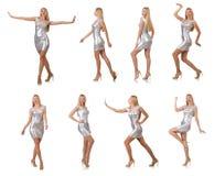 Die junge Frau im silbernen Kleid lokalisiert auf Weiß Lizenzfreie Stockfotografie