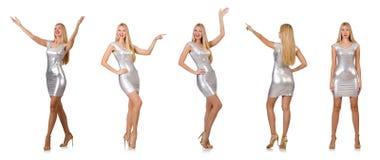Die junge Frau im silbernen Kleid lokalisiert auf Weiß Lizenzfreie Stockfotos