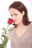Die junge Frau mit einer Blume Lizenzfreie Stockbilder