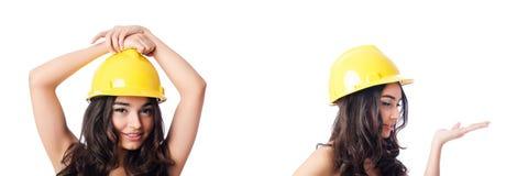 Die junge Frau mit gelbem Schutzhelm auf Weiß Stockbilder