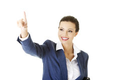 Die Geschäftsfrauherstellung wählt auf abstraktem Schirm Lizenzfreies Stockbild